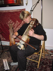 Hans Christian playing sarangi on Echoes with Rasa.